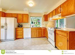 White Kitchen Cabinets White Appliances by Kitchen Room With Maple Cabinets And White Appliances Stock Photo