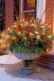 add lights to decorative urns for added glow next to your front