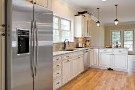 kitchen floor ideas with white cabinets small white kitchens white or black appliances with white cabinets