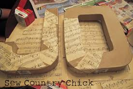 mod podged sheet music covered letters a christmas craft tutorial