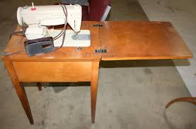 Singer Sewing Machine Desk A Humming Machine Loved As If