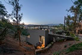 Building A House On A Slope Car Park House Anonymous Architects Archdaily