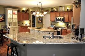 beautiful large space modern kitchen with bordeaux granite for