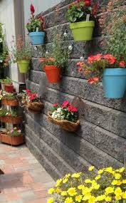 Garden Baskets Wall by Charming Metal Wall Hanging Flower Baskets Painted Clay Pots