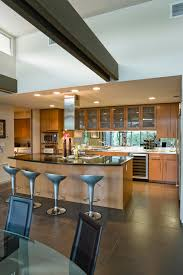 spacious kitchen with stools at island in house stock image