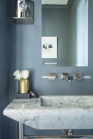 gold and blue powder room boasts slate blue paint on walls lined
