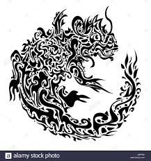 stylized twisted dragon tattoo on a white background stock photo
