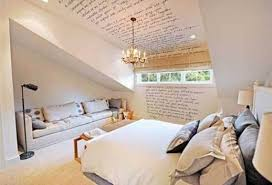 attic bedroom decorating with small chandelier and sofa and wall