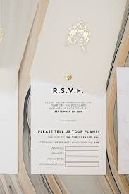 twist rotating wedding invitation suite gold foil logo on vellum