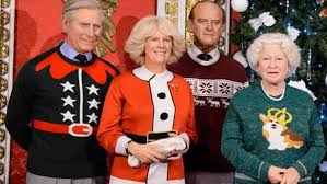 a waxed royal family wears funky sweaters for the holidays