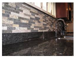 mixed color thin stone veneer as a backsplash in a kitchen made