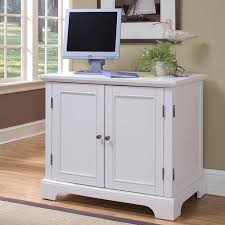 compact office cabinet and hutch computer desk that closes up to hide most of the computer items has