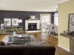 living room white bookcases black console table gray sofa brown