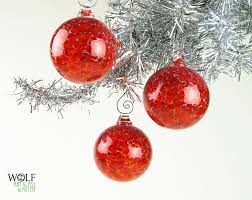 Glass Christmas Tree Ornament - drop dead gorgeous image of decorative red bauble blown glass