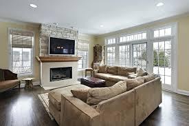 hardwood floor living room ideas gray and tan living room ideas family room with stone wall fireplace