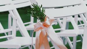 chair ribbons wedding decor on the chairs ribbons and flower on white chairs