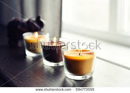 home interior candles cozy candles on wooden table home stock photo 594773555