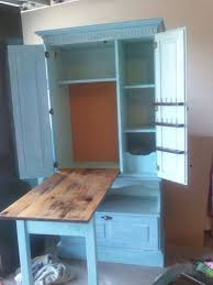 diy craft armoire with fold out table repurposed armoire sewing cabinet fold table top legs into