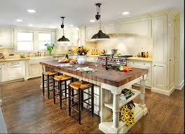 butcher u0027s block island in kitchen with cream colored cabinets and