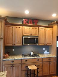 Top Of Kitchen Cabinet Decor by Please Help Me Choose Top Of Kitchen Cabinet Decor