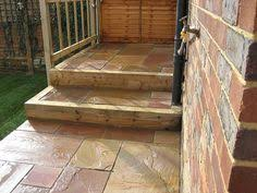 image result for indian sandstone patio with sleepers garden