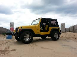 yellow jeep my in yellow at the beach with her doors off jeep