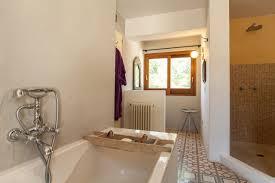 cn nic ibiza villa guru bath and shower in one of the bathrooms at casa arabela in ibiza