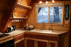 a frame kitchen ideas here s a simple and relatively tiny a frame cabin in the woods