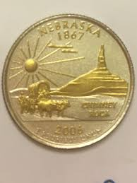 2006 nebraska quarter with some gold and lighter in weight d mint