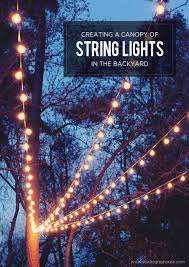 Battery Operated Umbrella String Lights by A Canopy Of String Lights In Our Backyard String Lights