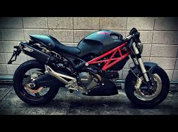 matte grey monster 696 with zard exhaust and red accents ducati