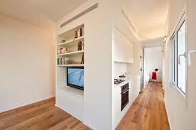 pretty white wall color for built in cabinet panels in space