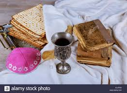 kosher for passover matzah kosher wine with a white plate of matzah or matza and a