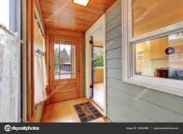 entrance porch interior with wood paneling u2014 stock photo