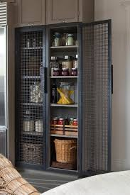metal pantry door spaces farmhouse with orange cabinetry
