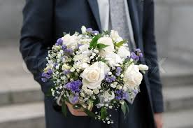 wedding flowers groom groom holding beautiful wedding flowers bouquet stock photo
