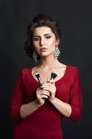 pretty woman earrings pretty woman wearing dress and big earrings holding makeup