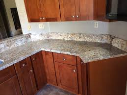 granite countertop backsplash for dark cabinets and light