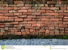 red stone brick wall with pavement royalty free stock photo