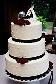 elegant fondant wedding cake with plum purple damask quilting