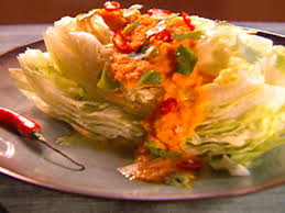 iceberg lettuce with carrot ginger soy dressing with cilantro and