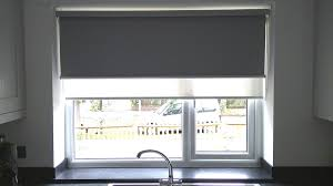 dual double roller blinds installed to kitchen window using double