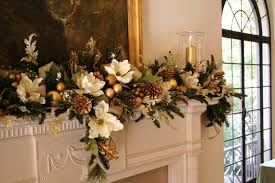 elegant red mantel christmas garland and gold pillar candles