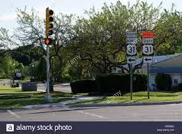 traffic signal on a street post in a small town usa highway signs