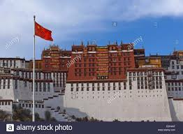 Chineses Flag China Tibet Lhassa Potala Palace And Chinese Flag Stock Photo