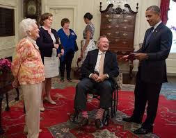 George H W Bush Date Of Birth George H W Bush Gives Obama A Pair Of Socks Photo Huffpost