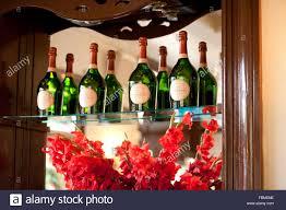 wine and spirit bottles resting on an ornamental shelf uk
