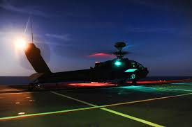 file army apache helicopter practices deck landing operations with