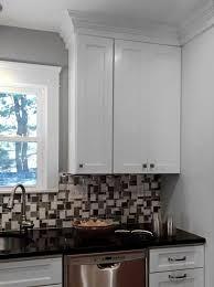 White Cabinets Granite Countertops by Black Granite Countertop With Mosaic Backsplash And White