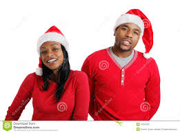 african american christmas couple with santa hats stock photo